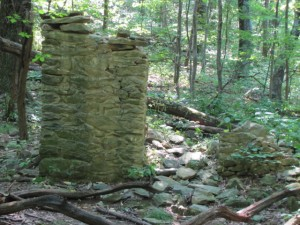 a stone foundation of a ruined building