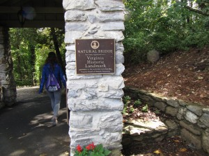 a plaque on a white stone pillar noting that Natural Bridge is a Virginia Historic Landmark