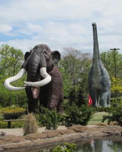 mastadon and long neck dinosaur statues at mini golf