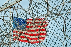 torn flag and barbed wire