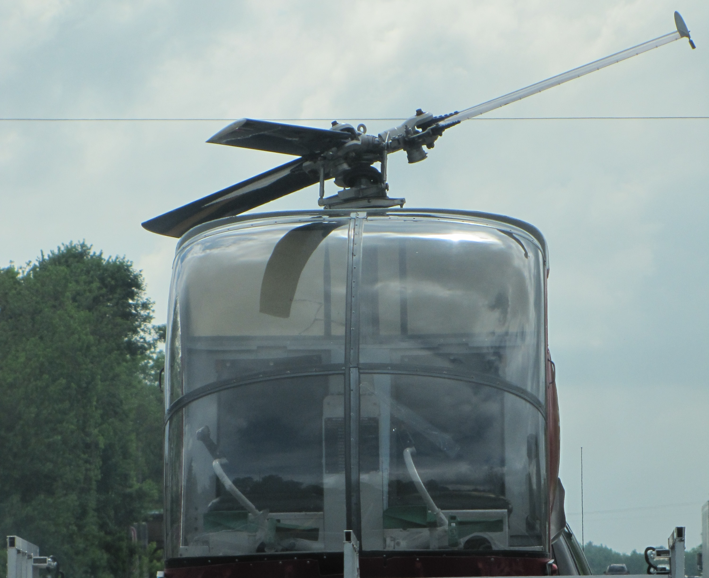 an empty helicopter cockpit as viewed from in front
