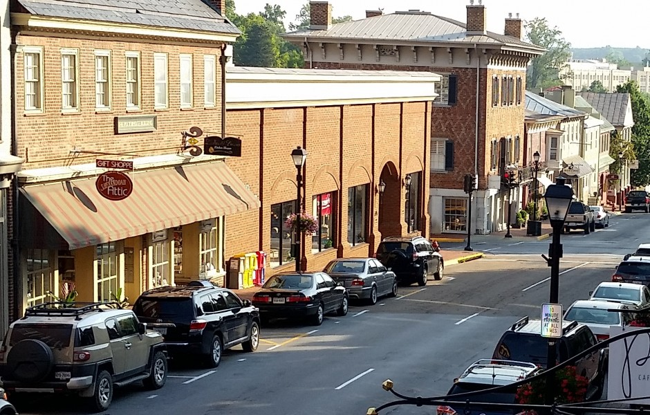 downtown area with brick buildings and cars lining the street