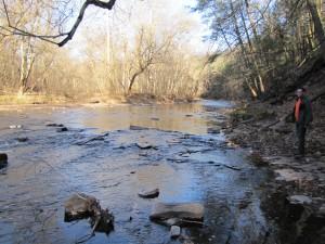 creek, man standing on bank