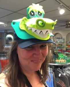 woman wearig a goofy looking foam hat with an alligator head