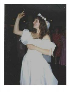 A bride tossing her bouquest over her right shoulder
